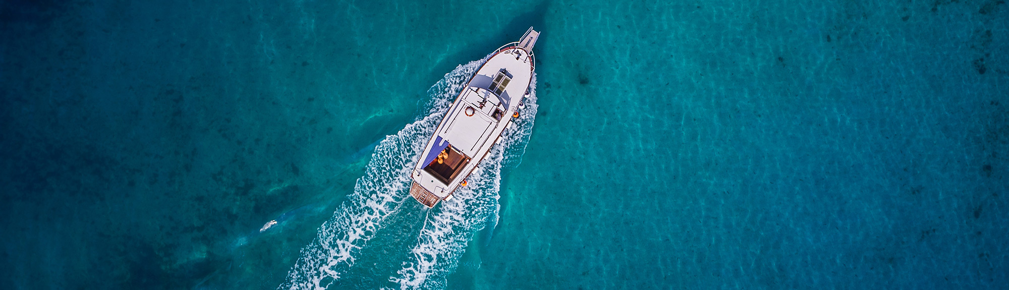 Birds Eye view of yacht in clear blue waters